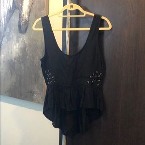 Peplum fishtail top with brass cut outs